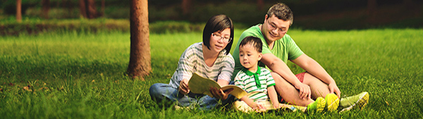Family in park reviewing personal loan options