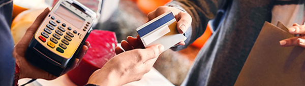 User using credit card to pay for shopping