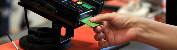 User inserting chip card into scanner