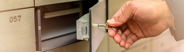 User unlocking safety deposit box