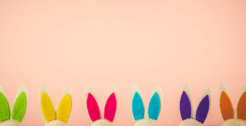 brightly colored bunny ears at the bottom of a pink background