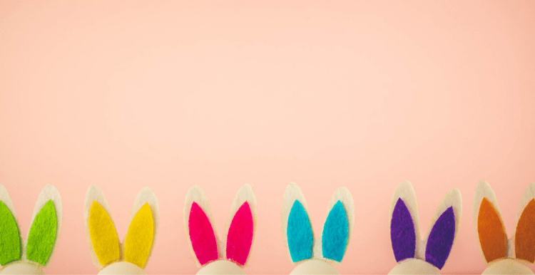 brightly colored felt bunny ears at the bottom of a pink background